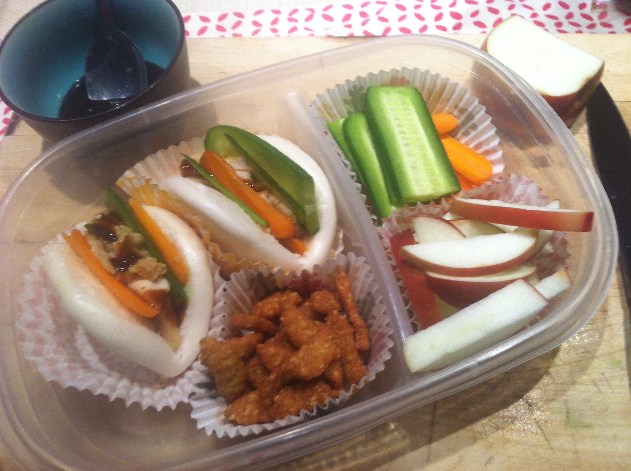 "Chicken ""banh mi"" sandwiches with sesame sticks, apples, and veggies"